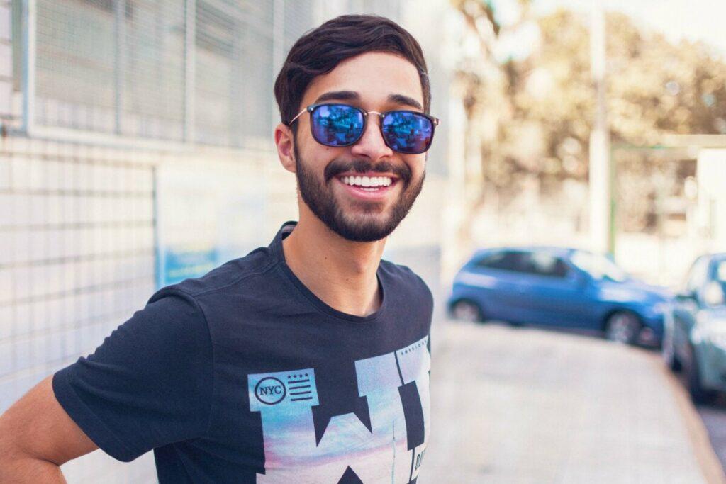 Virgo edit of a smiling man wearing sunglasses