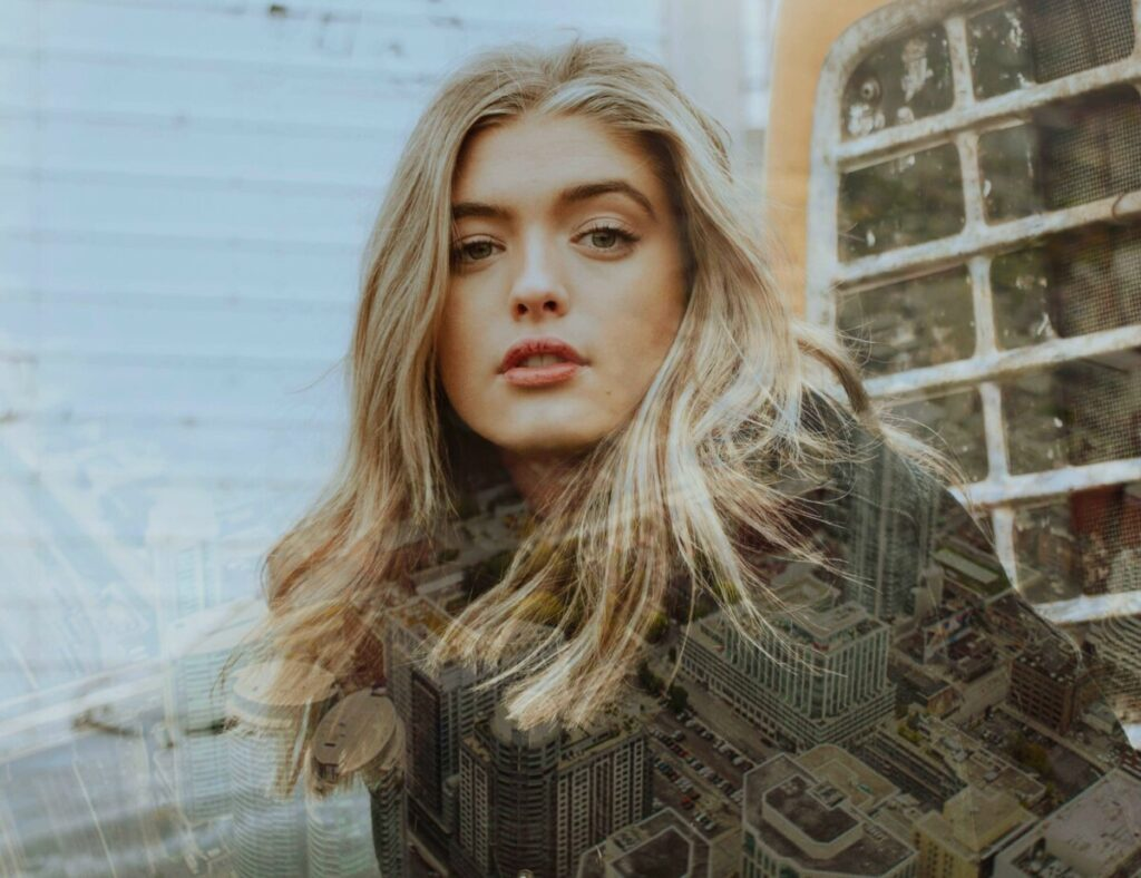 Photo of blonde woman with Metro filter creating a layer of city skyline