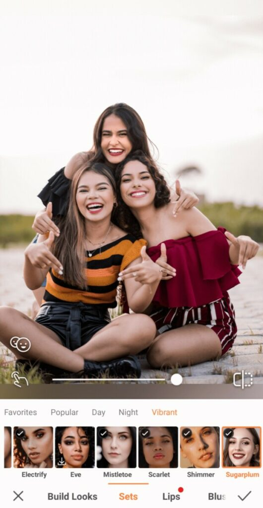 Group Photo of three smiling women taking a photo on the beach