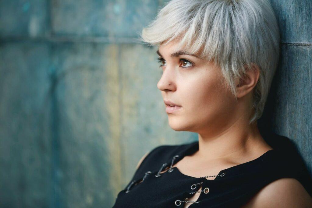 woman with blonde pixie cut hair