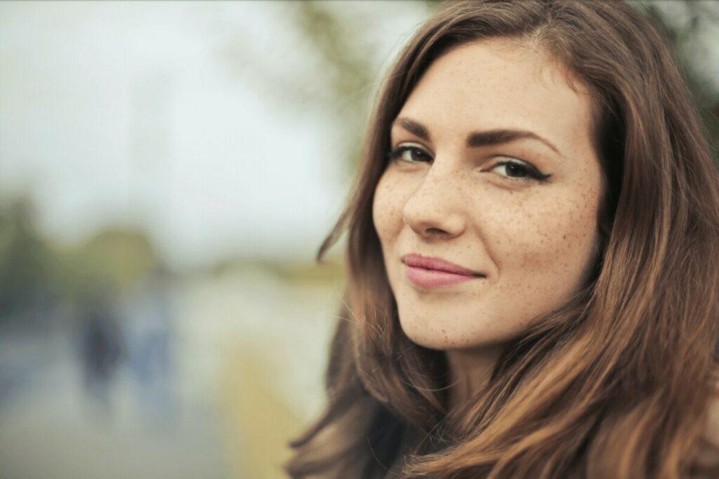 closeup of a smiling brunette woman