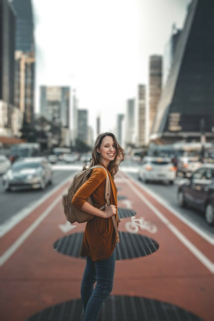 woman standing in the middle of a busy city street