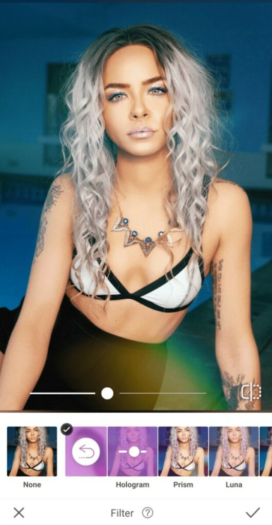 Holographic edit featuring woman with gray hair and colorful makeup