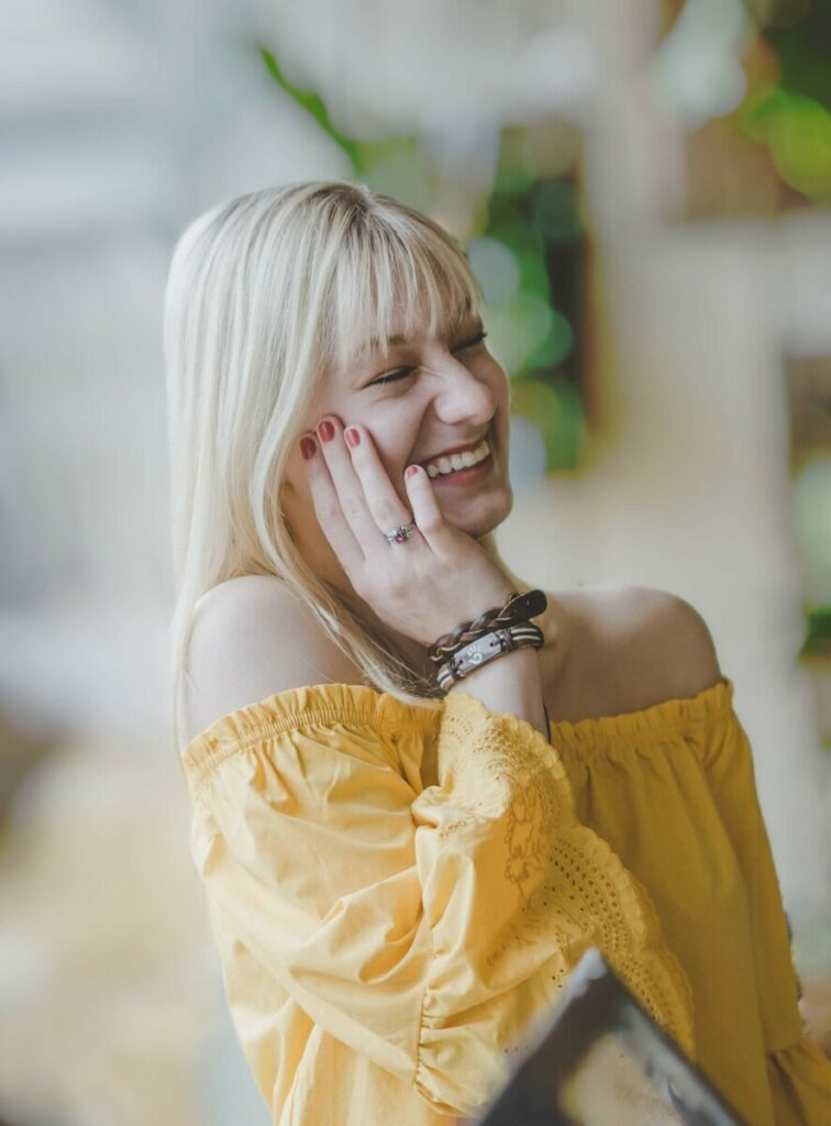 Cancer edit with woman in yellow top laughing