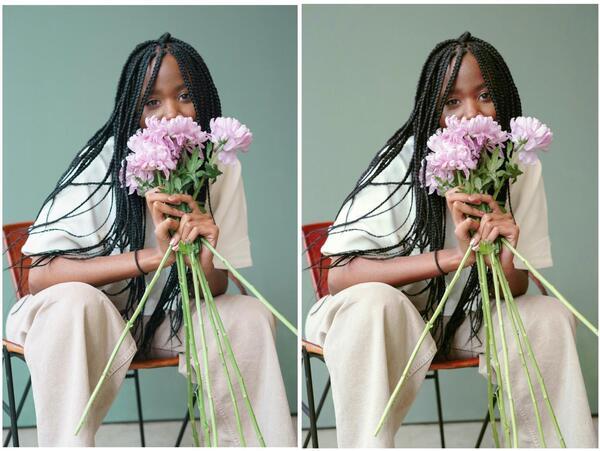 mulher negra sentada segundo um buquê de flores