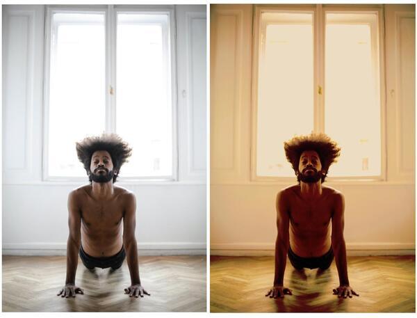 homem negro praticando ioga no chão