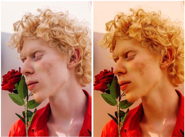 homem loiro segurando uma flor rosa