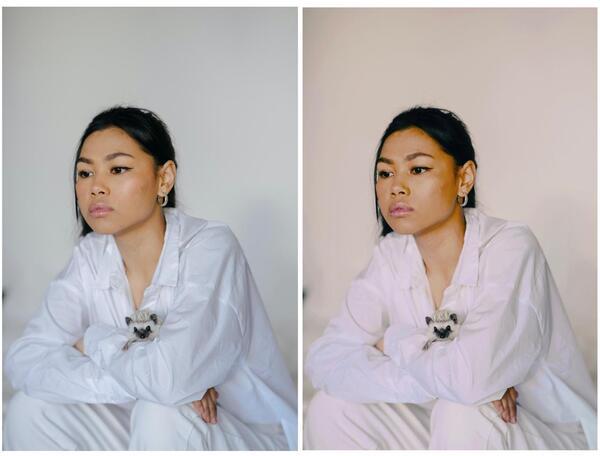 Mulher asiática sentada e pensativa