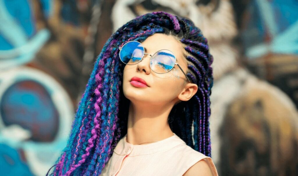 woman with colorful braids in her hair
