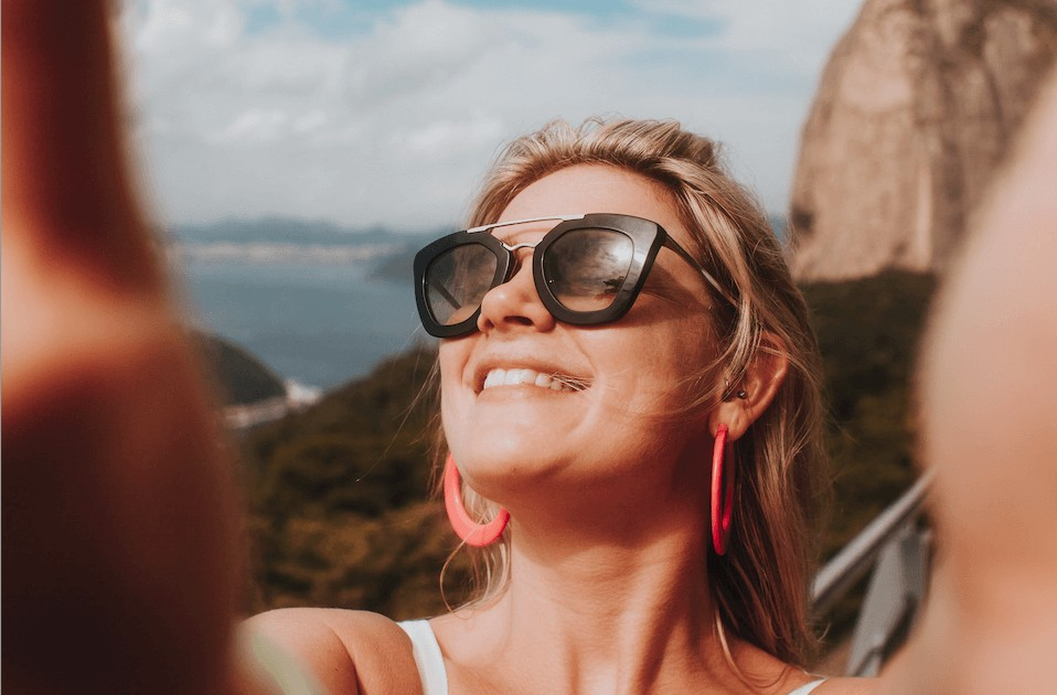 woman with sunglasses taking a selfie