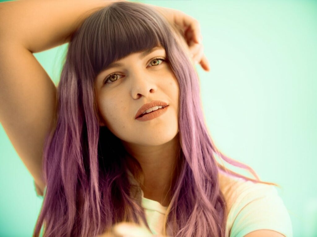 Woman with purple hair and bangs