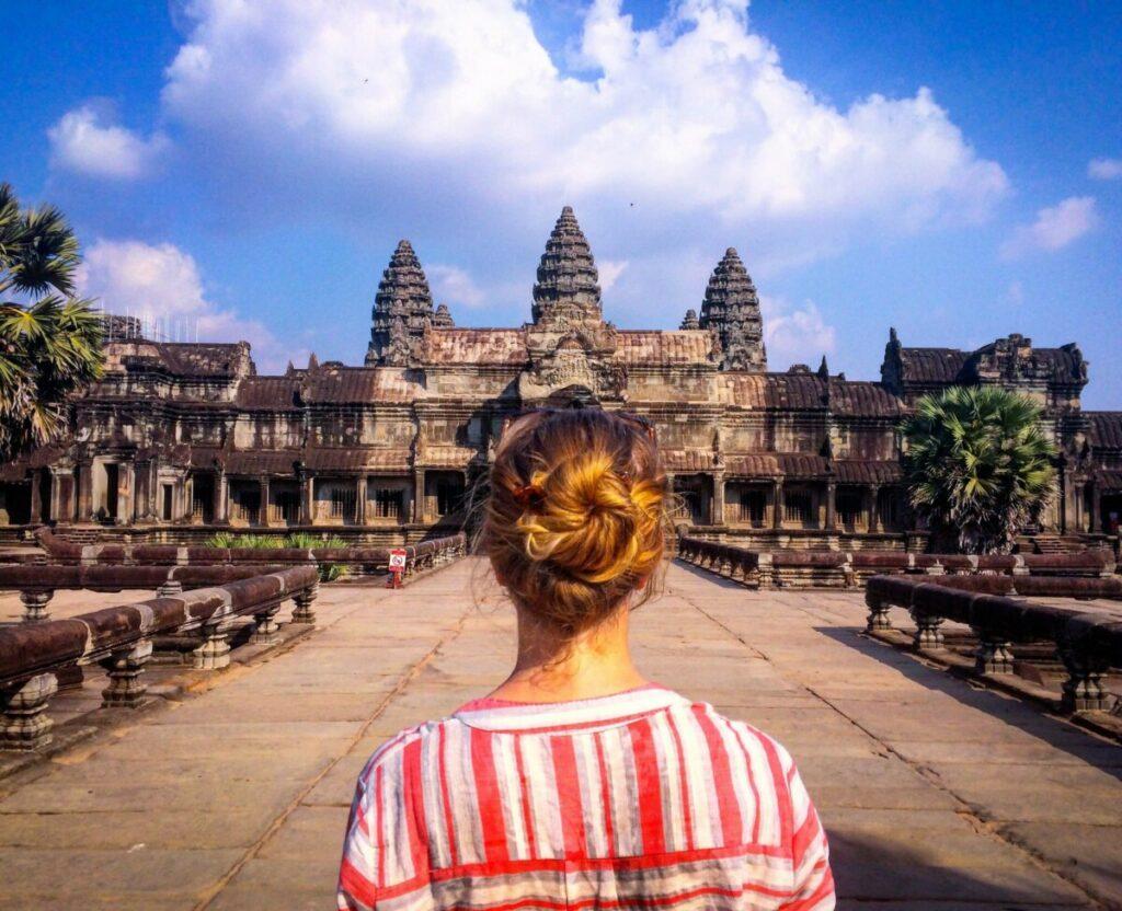 woman facing ancient temple