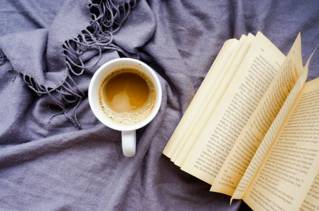 overhead photo of book and coffee