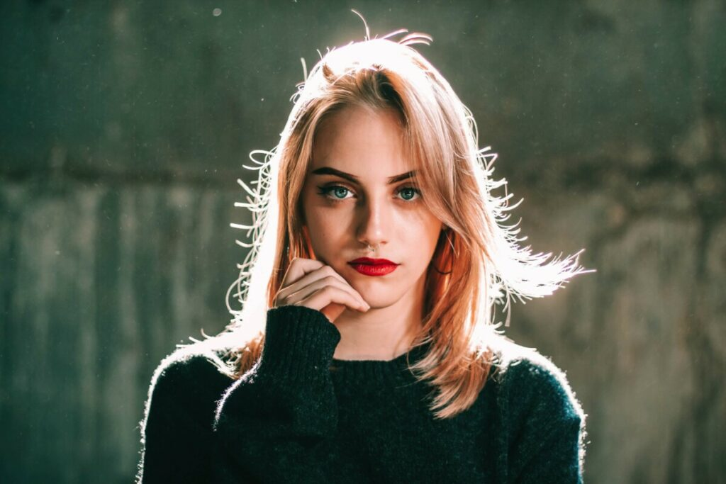 woman with red lips wearing a black sweater