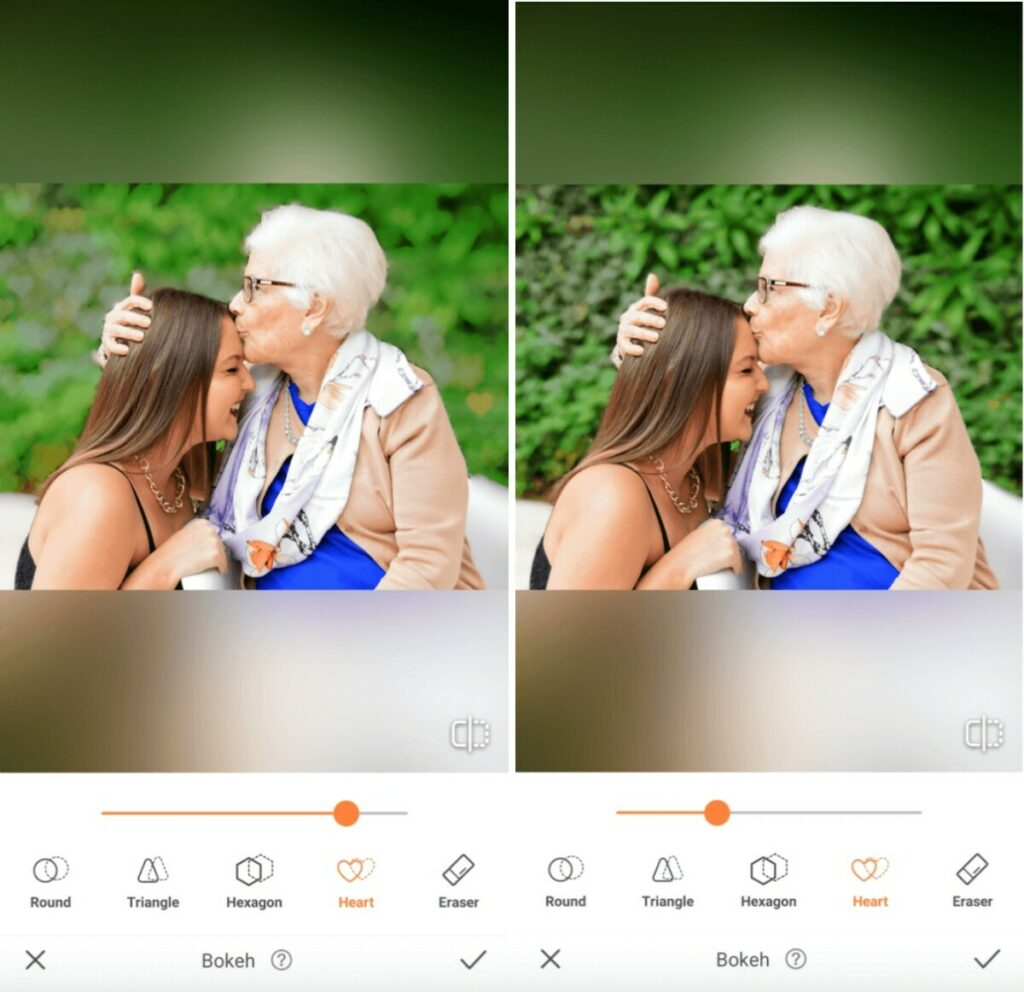 Grandmother kisses her granddaughter on the forehead