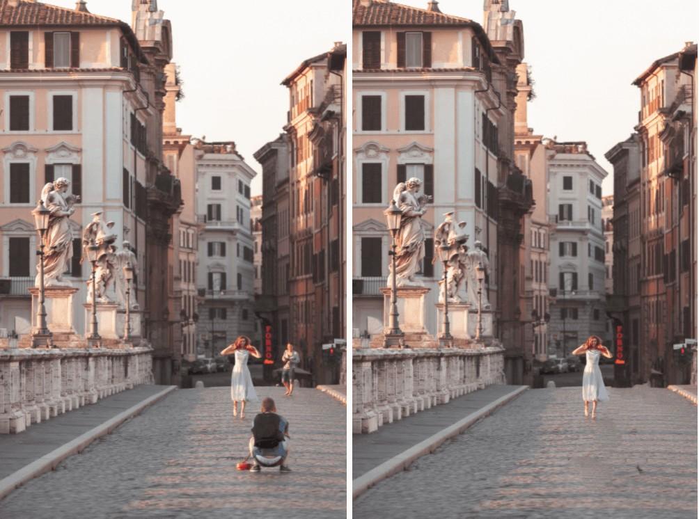woman in a white dress walking across a cobble stoned bridge