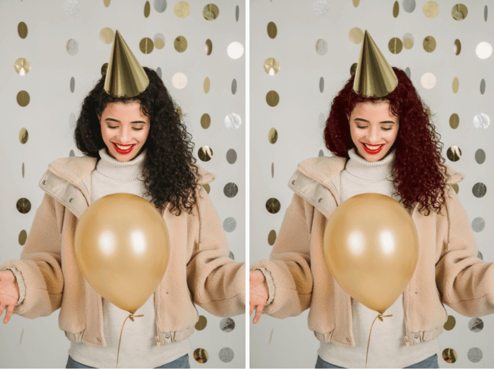 woman celebrating with a gold balloon and party hat